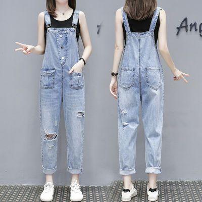 欧洲站破烂水洗牛仔背带裤女欧货显瘦显高破洞吊带九分连体裤薄款