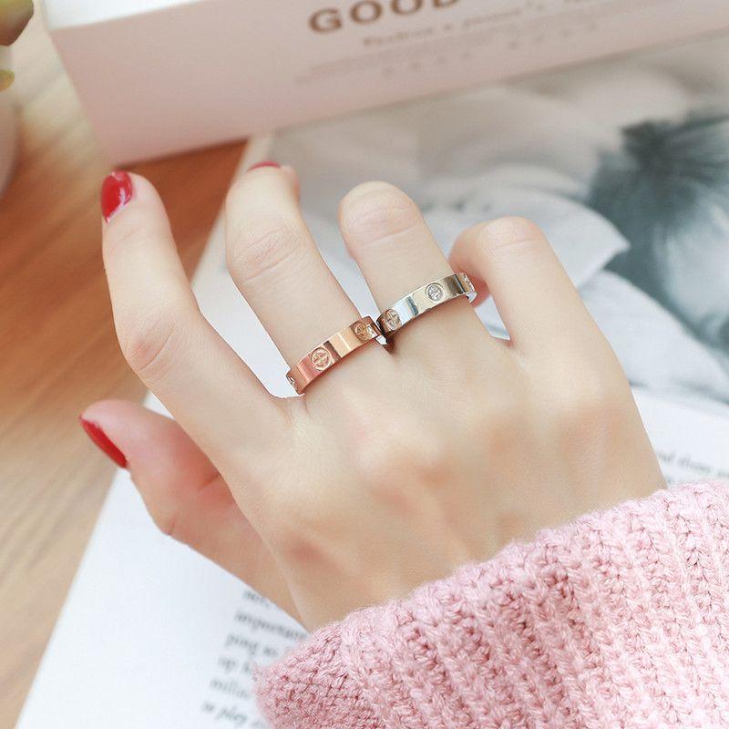 便宜的时尚网红玫瑰金黑白色陶瓷戒指男女情侣钛钢对戒食指尾戒单身百搭
