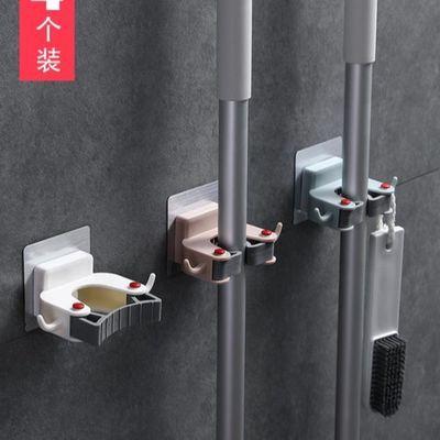 免打孔拖把挂钩强力粘胶扫把挂架浴室家用免钉壁挂式墙上拖把夹子