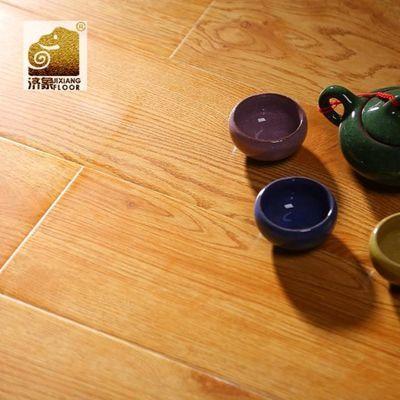 强化复合木地板厂家直销12mm家用卧室阳台环保E1地暖防水济象品牌