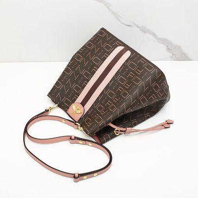 Fion/菲安妮欧美时尚女包新款单肩包 斜挎水桶包时尚蜜蜂包中包