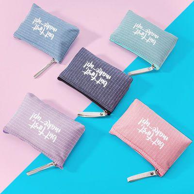 可爱字母防水帆布印花化妆包便携小号女士网红包零钱手机包钥匙包