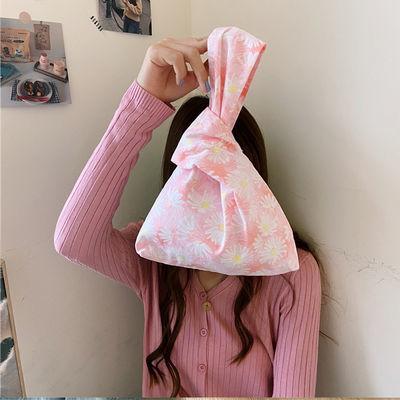 2020年新款时尚小雏菊手腕包女日式手挽零钱袋手提小包包帆布