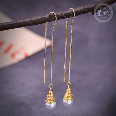 气质流苏耳线珍珠手工缠绕设计感耳环长款超仙镂空圆形耳坠网红款