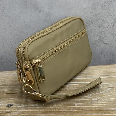 女士手拿包小包包2020新款时尚牛津布手抓包简约百搭气质帆布手包
