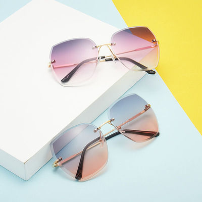 36215/2021彩色网红新款时尚显脸小墨镜无框切边女眼镜百搭防紫外线眼镜